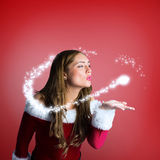 Composite image of santa girl blowing a kiss Stock Photo