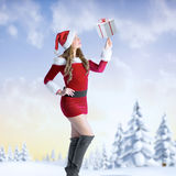 Composite image of sexy santa girl looking up Royalty Free Stock Photography