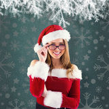 Composite image of sexy santa girl wearing spectacles Royalty Free Stock Images
