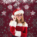 Composite image of sexy santa girl wearing spectacles Royalty Free Stock Image