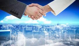 Composite image of shaking hands Stock Photography