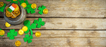 Composite image of shamrock, coins and irish flag royalty free stock images