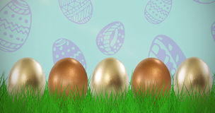 Composite image of shiny easter eggs arranged side by side Royalty Free Stock Photo