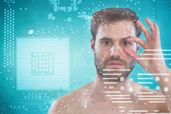 Composite image of shirtless man opening his eye with fingers Royalty Free Stock Photo
