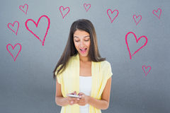 Composite image of shocked casual woman reading a text Stock Images