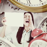 Composite image of shouting brunette holding page Royalty Free Stock Photo