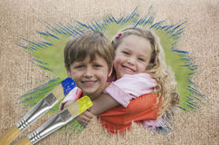 Composite image of sibling smiling in the park Royalty Free Stock Images