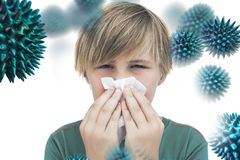 Composite image of sick little boy with a handkerchief. Sick little boy with a handkerchief against virus stock photo