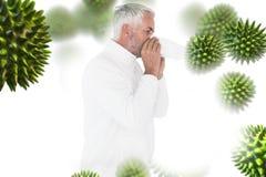 Composite image of sick man in winter fashion sneezing. Sick man in winter fashion sneezing against virus stock image