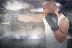 Composite image of side view of boxer hitting straight Stock Image