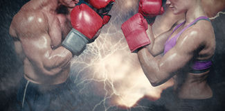 Composite image of side view of boxers with fighting stance. Side view of boxers with fighting stance against splashing of powder Royalty Free Stock Photos