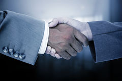 Composite image of side view of business peoples hands shaking Royalty Free Stock Images