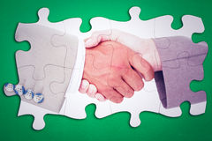 Composite image of side view of business peoples hands shaking Stock Photo