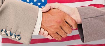 Composite image of side view of business peoples hands shaking Royalty Free Stock Photo