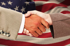 Composite image of side view of business peoples hands shaking Royalty Free Stock Photography
