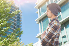 Composite image of side view of confident hipster with arms crossed Royalty Free Stock Photos