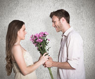 Composite image of side view of couple holding flowers Stock Images