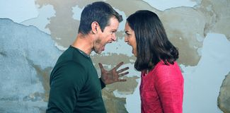 Composite image of side view of couple shouting standing face to face Stock Photos