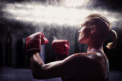Composite image of side view of female boxer with fighting stance Royalty Free Stock Images