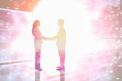 Composite image of side view of hand shaking trading partners Royalty Free Stock Image