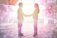 Composite image of side view of hand shaking trading partners Royalty Free Stock Photo