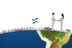 Composite image of side view of hand shaking trading partners Stock Photo