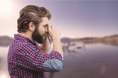 Composite image of side view of hipster photographing with camera Stock Images