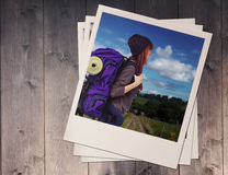 Composite image of side view of a hipster woman with a travel bag. Side view of a hipster woman with a travel bag against wooden planks Stock Image