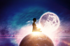 Composite image of side view of person practicing meditation. Side view of person practicing meditation against digitally composite image of colorful lights stock images