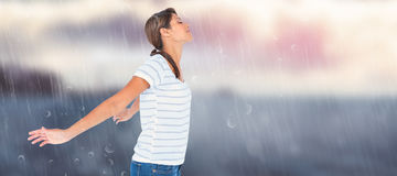 Composite image of side view of relaxed woman with arms outstretched Stock Image