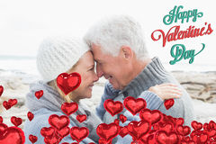 Composite image of side view of a romantic senior couple. Side view of a romantic senior couple against cute valentines message royalty free stock photos