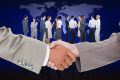 Composite image of side view of shaking hands Stock Photography