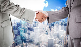 Composite image of side view of shaking hands Royalty Free Stock Photos