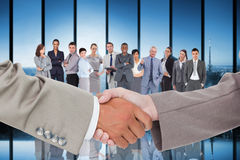 Composite image of side view of shaking hands Royalty Free Stock Photo