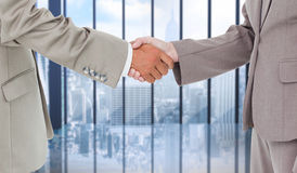 Composite image of side view of shaking hands Royalty Free Stock Image