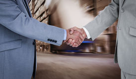 Composite image of side view of shaking hands Stock Images