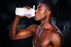 Composite image of side view of a sporty man drinking protein Stock Photo