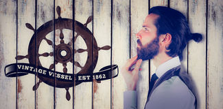 Composite image of side view of thoughtful businessman. Side view of thoughtful businessman against wood background Royalty Free Stock Photos