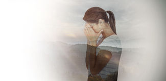 Composite image of side view of upset woman covering face Stock Photos