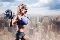 Composite image of side view of woman exercising with crossfit Stock Image