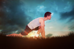 Composite image of side view of a young man in ready to run posture Stock Photo