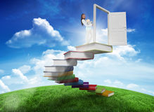 Composite image of side view of young woman carrying a pile of books Stock Photo