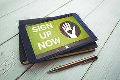 Composite image of sign up now text with icons on green screen. Sign Up Now text with icons on green screen against tablet and pen on desk royalty free stock photos