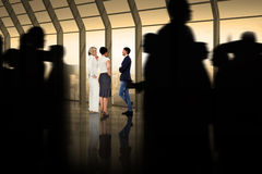 Composite image of silhouette of business people walking Royalty Free Stock Photo