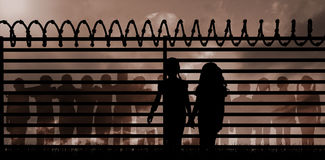Composite image of silhouette girls holding hands Stock Image