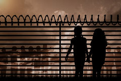 Composite image of silhouette girls holding hands Royalty Free Stock Photography