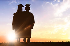 Composite image of silhouette of graduate Stock Photos