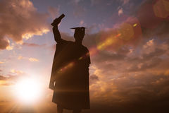 Composite image of silhouette of graduate Stock Photo
