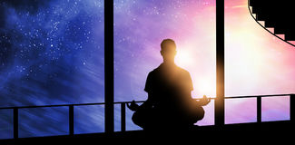 Composite image of silhouette man doing meditation Royalty Free Stock Photography