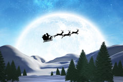 Composite image of silhouette of santa claus and reindeer Stock Image